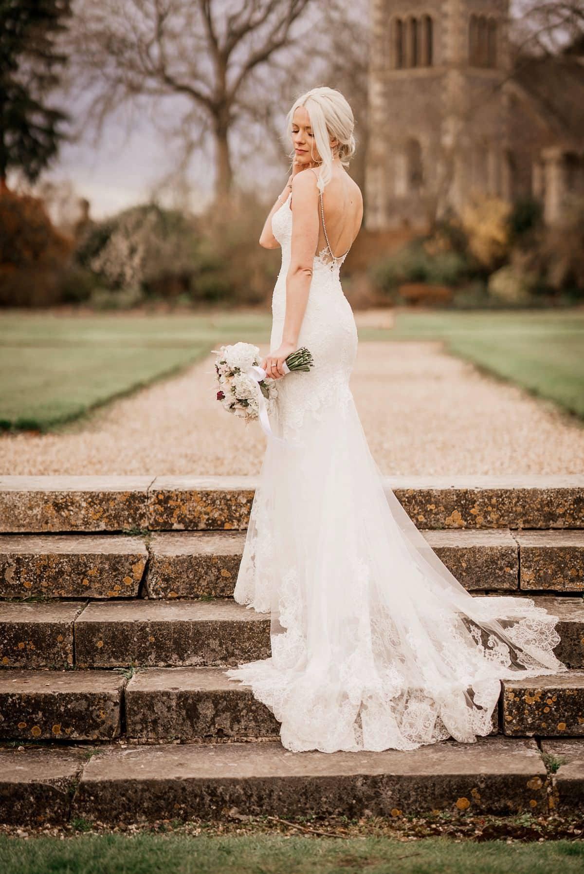 bride on steps at the elvetham